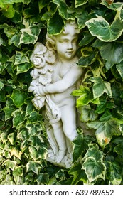 A small statue with leaves around it