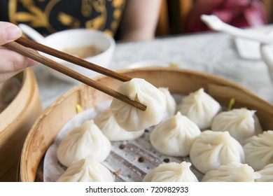 small steamed bun in bamboo pan