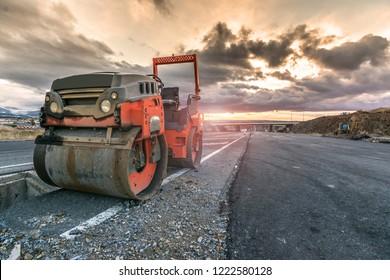 Small steamroller repairing a highway