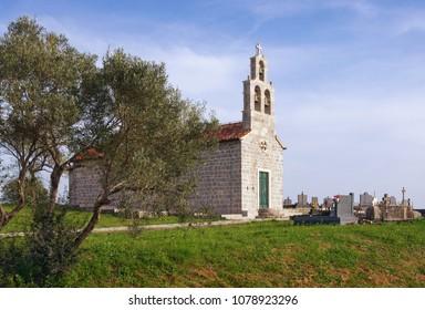 Small stone church with churchyard. Montenegro, church of Saint Ivan ( Sveti Ivan) in the Tivat village Bogisici
