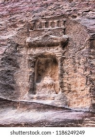 A small stone niche in the shape of a temple is carved into the canyon walls of the siq that leads to the ancient necropolis of Petra in Jordan.