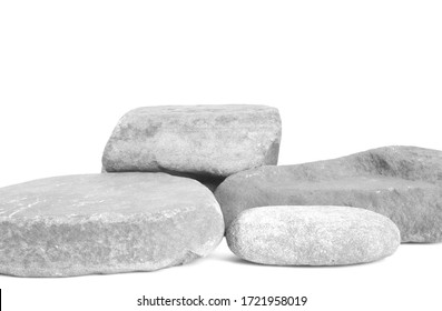 Small stones arranged at different heights in white tones. Background or template for designing cosmetic and jewelry products