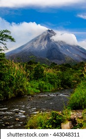 A small stream in Costa Rica with Arenal Volcano in the background.