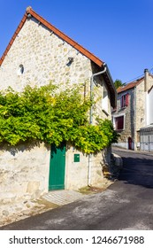 Small street and houses in Auvers-sur-Oise, France