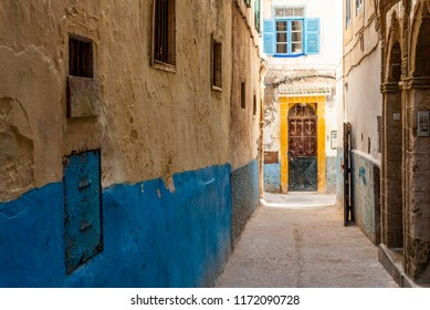 A small street in the medina of Essaouira in Morocco. The bottom of the walls is painted in blue
