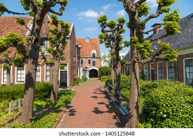 Small street in the old public courtyard 'Pepergasthuis' in the Dutch city of Groningen on a spring day.