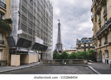 small street in paris with view on the famous eifel tower