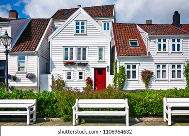 Small street with white low houses  in the city of Stavanger, Norway