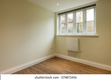 Small study, office or bedroom in empty New residential Home with wooden floor
