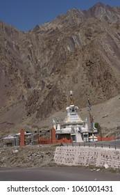 Small stupas and chortens in steep mountain valley near Lamayuru gompa monastery, Ladakh, India