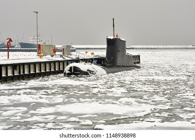Small submarine in the winter port