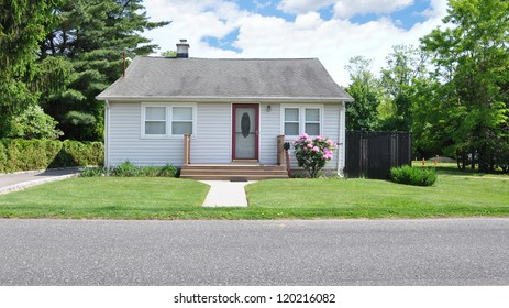 Small Suburban Bungalow Cottage Home Blooming Rhododendron Flowers Sunny Day