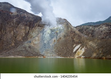 Small sulfur lake on active mountain. Beautiful landscape of mount Papandayan. Papandayan Mountain is one of the favorite place to hike on Garut.