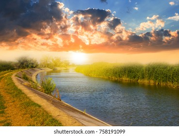 small summer river at the sunset landscape