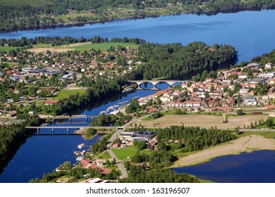 Small Swedish town, colorful and vivid areal view on river, lake, houses and three bridges