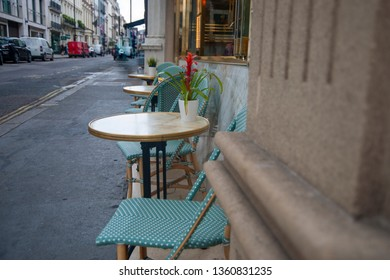 Small table and some chairs from the street cafe in the city.