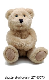 A small teddy bear isolated on white with his hands being folded.