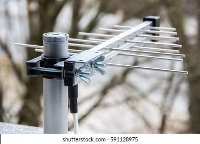 Small television aerial antenna outside on windows sill – Digital DVB-T TV signal