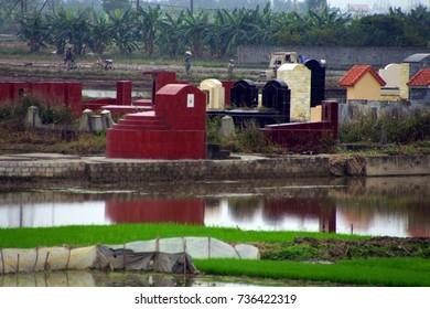 Small Tombs in rice paddies, near Haiphong,  Vietnam