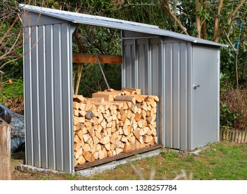 Small Tool Shed with integrated Firewood Pile for Barbecue grilling