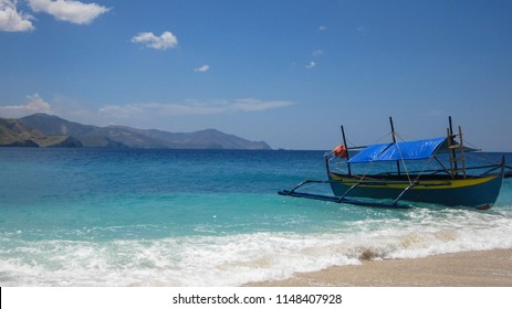 A small tourist boat docked at Capones island Zambales Philippines.