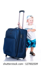 Small tourist with suitcase on white background