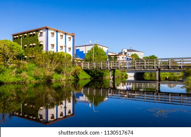 Small touristic landmark with a canal and reflection at the village Oranje in the center of province Drenthe, the Netherlands.