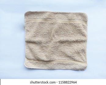 Small towel for face or cleaning. Top-down. Isolated on white background.