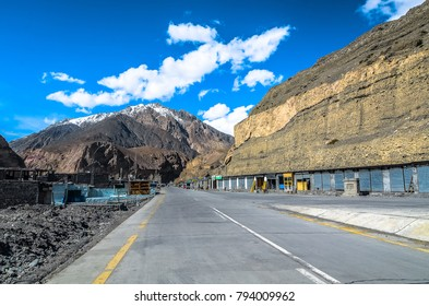 small town along karakoram highway with a view of snowy mountain