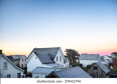 Small town America view of rooftops in early morning light. Copy space