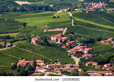 Small town among green vineyards on the hills in Piedmont, Northern Italy.