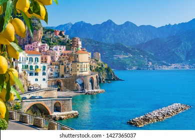 Small town Atrani on Amalfi Coast in province of Salerno, Campania region, Italy. Amalfi coast on Gulf of Salerno is popular travel and holyday destination in Italy. Ripe yellow lemons in foreground.