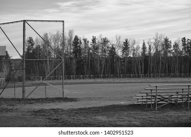 Small town baseball field with empty bleachers