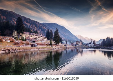 A small town in the Dolomites Italian Alps, a lake, a beautiful urban natural autumn landscape, Madonna di Campiglio