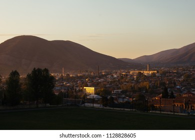 small town at the foot of the mountains at sunset