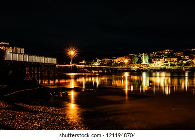 Small town at night with reflection of the lights on the water