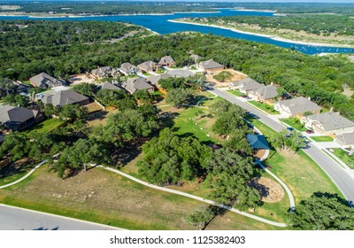 Small town north of Austin , Texas . 100% fossil fuel free city in central Texas. Aerial drone view above Real estate development houses and homes in suburb Georgetown , Texas view of Georgetown lake
