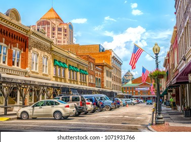 Small Town quaint USA main street hometown commercial storefront shops with flag in downtown Roanoke Virginia