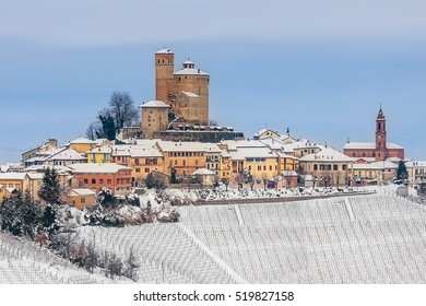 Small town of Serralunga d'Alba on hill covered with snow in Piedmont, Northern Italy.