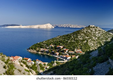 Small town Starigrad kod Senja and the island Goli otok