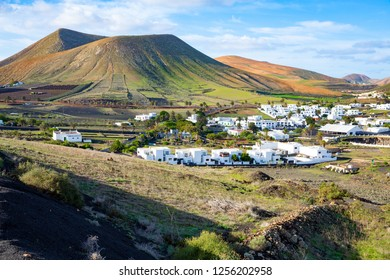 Small town Uga and crater landscape on Lanzarote Island, Canary Islands, Spain