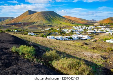 Small town Uga and the volcanic surroundings on Lanzarote Island, Canaries, Spain