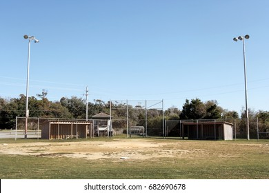 Small town USA baseball park. Worn infield and blue sky.