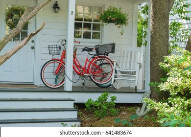 Small Town USA - red bicycle bikes on a southern front porch - Beaufort North Carolina vacation beach destination