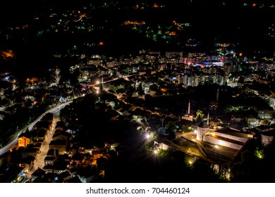 Small town in the valley at near midnight