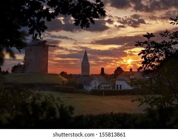 Small town with a windmill at sunset in de Achterhoek Gelderland