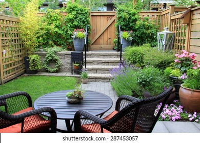 garden patio furniture. Small Townhouse Garden With Patio Furniture Amidst Blooming Lavender.