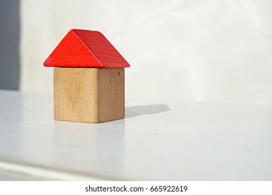 Small toy houses from wooden blocks ,Houses made from children's wooden building blocks on sunlight ,Little wooden house made of toy blocks