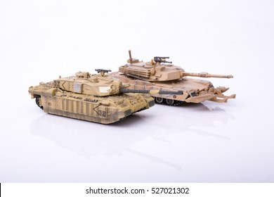 Small toy tanks Isolated on a white background.