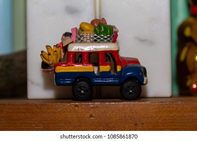 A small toy van colored yellow, red and blue, a memory of a journey.